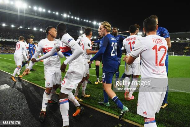 Tom Davies of Everton clashes with Lyon players after a challenge by Ashley Williams of Everton on Anthony Lopes of Lyon during the UEFA Europa...