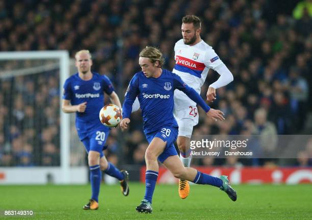 Tom Davies of Everton FC beats Lucas Tousart of Olympique Lyon during the UEFA Europa League group E match between Everton FC and Olympique Lyon at...