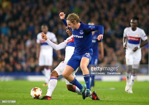 Tom Davies of Everton FC is challenged by Kenny Tete of Olympique Lyon during the UEFA Europa League group E match between Everton FC and Olympique...