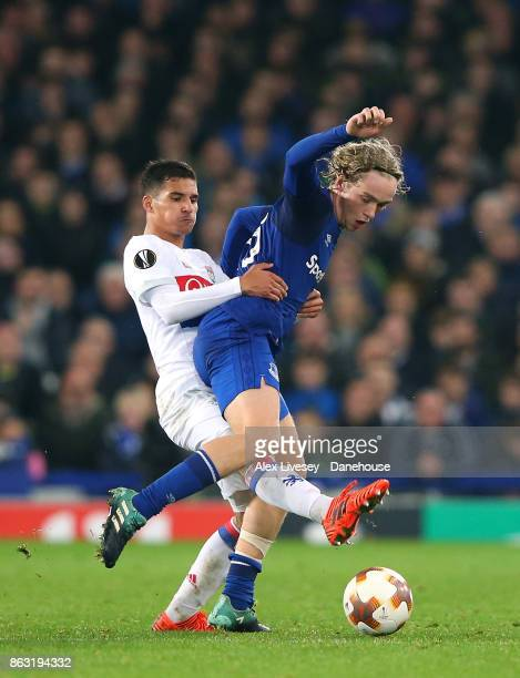 Tom Davies of Everton FC is tackled by Houssem Aouar of Olympique Lyon during the UEFA Europa League group E match between Everton FC and Olympique...