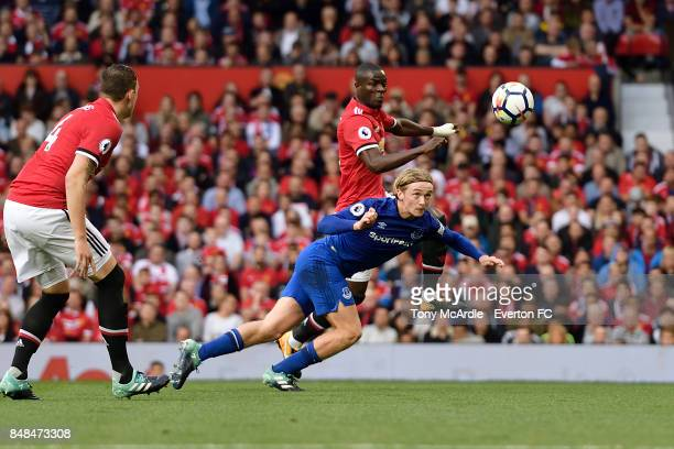 Tom Davies of Everton heads the ball during the Premier League match between Manchester United and Everton at Old Trafford on September 17 2017 in...