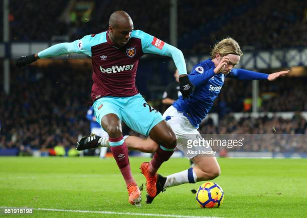 Tom Davies of Everton is challenged by Angelo Ogbonna of West Ham United during the Premier League match between Everton and West Ham United at...