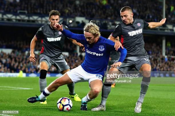 Tom Davies of Everton is challenged by Josip Radosevic of Hajduk Split during the UEFA Europa League Qualifying PlayOffs round first leg match...