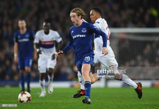 Tom Davies of Everton is chased by Kenny Tete of Lyon during the UEFA Europa League Group E match between Everton FC and Olympique Lyon at Goodison...