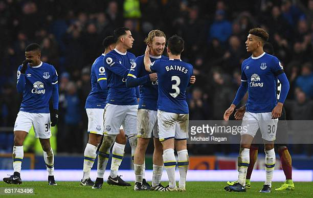 Tom Davies of Everton is congratulated by teammate Leighton Baines during the Premier League match between Everton and Manchester City at Goodison...