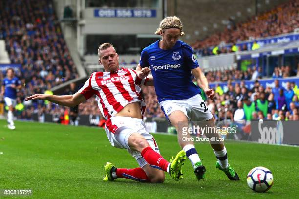 Tom Davies of Everton is tackled by Ryan Shawcross of Stoke City during the Premier League match between Everton and Stoke City at Goodison Park on...