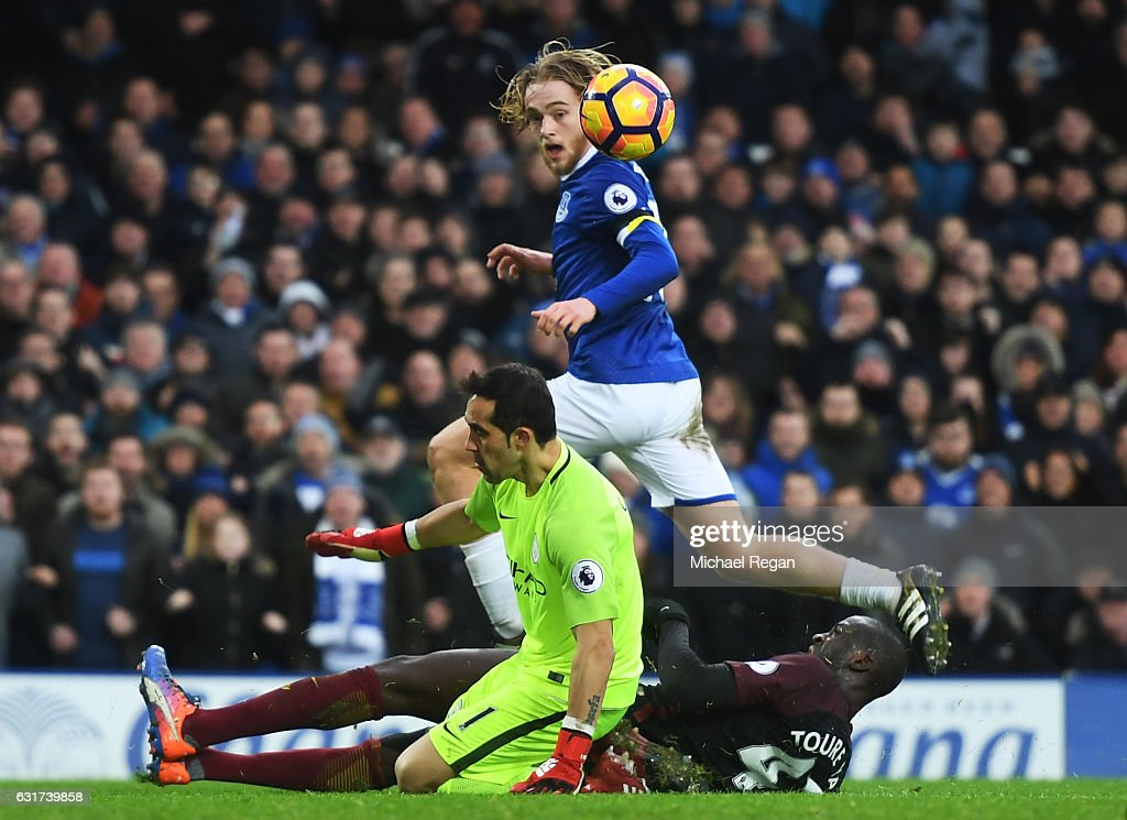 Tom Davies of Everton lifts the ball over goalkeeper Claudio Bravo of Manchester City to score his team's third goal during the Premier League match between Everton and Manchester City at Goodison Park on January 15, 2017 in Liverpool, England.
