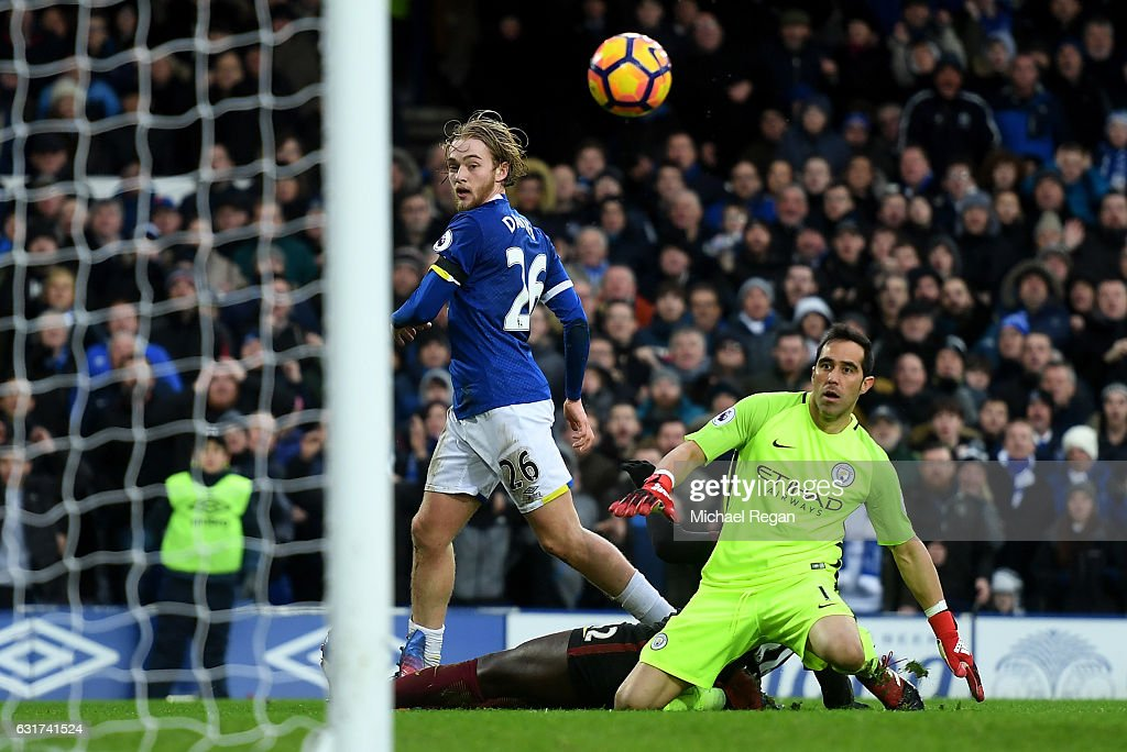 http://media.gettyimages.com/photos/tom-davies-of-everton-lifts-the-ball-over-goalkeeper-claudio-bravo-of-picture-id631741524