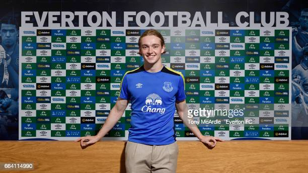 Tom Davies of Everton poses for a photo as he signs a new contract at USM Finch Farm on April 3 2017 in Halewood England