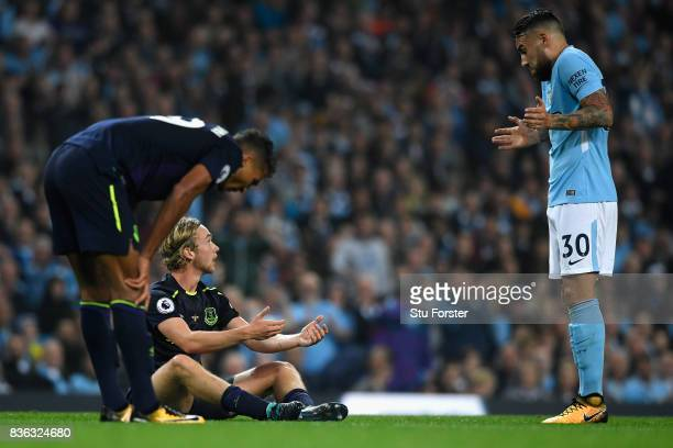 Tom Davies of Everton reacts as Nicolas Otamendi of Manchester City looks on during the Premier League match between Manchester City and Everton at...