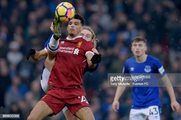 Tom Davies of Everton steals the ball from Dominic Solanke during the Premier League match between Liverpool and Everton at Anfield on December 10...
