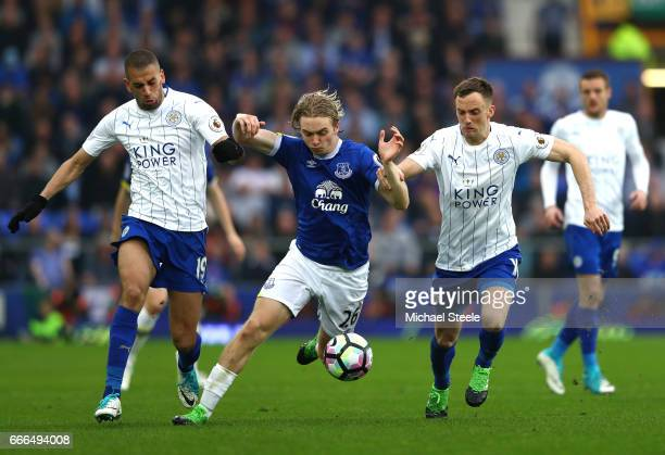 Tom Davies of Everton takes on Islam Slimani and Andy King of Leicester City during the Premier League match between Everton and Leicester City at...