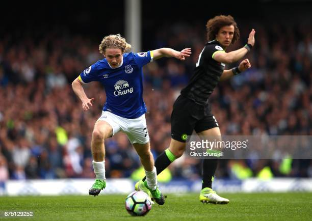 Tom Davies of Everton takes the ball past David Luiz of Chelsea during the Premier League match between Everton and Chelsea at Goodison Park on April...