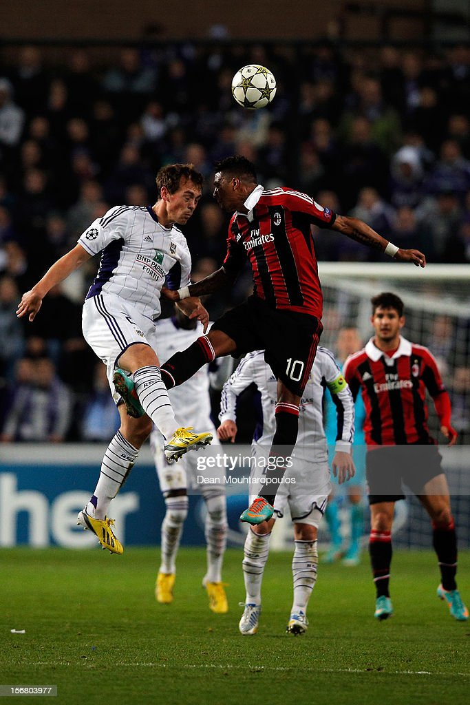 Tom De Sutter of Anderlecht and Kevin-Prince Boateng of AC Milan battle for the ball during the UEFA Champions League Group C match between RSC Anderlecht and AC Milan at the Constant Vanden Stock Stadium on November 21, 2012 in Anderlecht, Belgium.