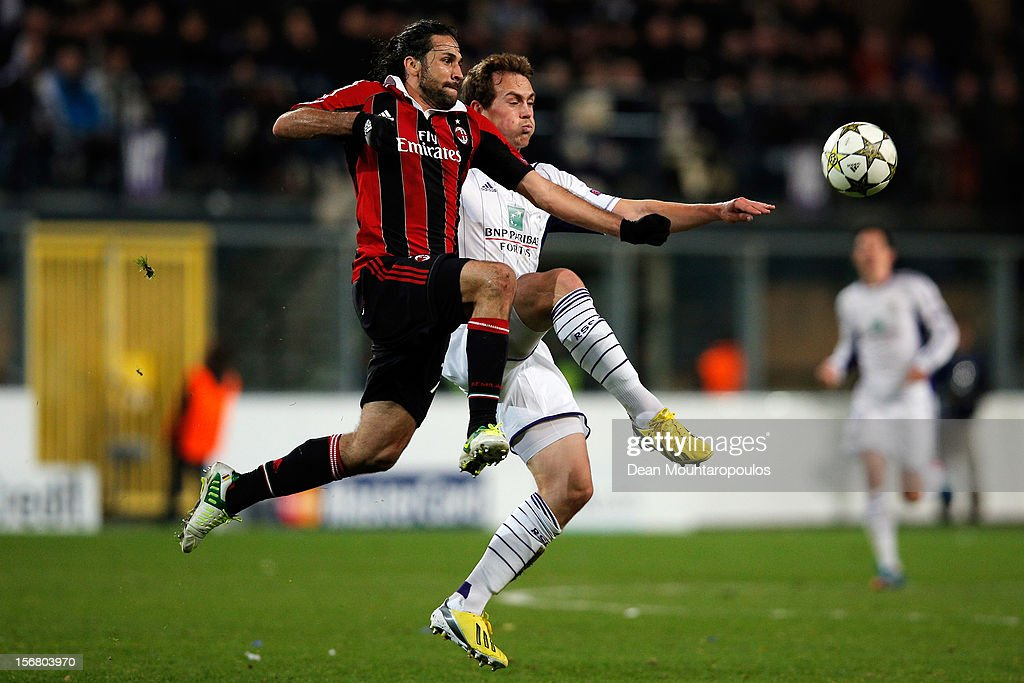 Tom De Sutter of Anderlecht and Mario Yepes of AC Milan battle for the ball during the UEFA Champions League Group C match between RSC Anderlecht and AC Milan at the Constant Vanden Stock Stadium on November 21, 2012 in Anderlecht, Belgium.