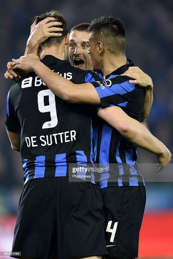Tom De Sutter of Club Brugge celebrates scoring a goal with team-mates Oscar Duarte of Club Brugge and Timmy Simons of Club Brugge during the Jupiler Pro League Play-Off 1 match between Club Brugge and Sporting Lokeren on March 28, 2014 in the Jan Breydel Stadium in Brugge, Belgium.