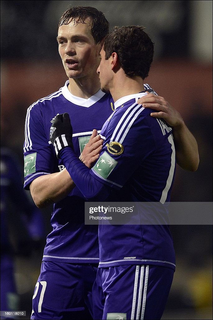 Tom De Sutter of RSC Anderlecht and Oleksandr Iakovenko of RSC Anderlecht celebrate the win during the Jupiler League match between Sporting Lokeren and Sporting Anderlecht on January 26, 2013 in Lokeren, Belgium.