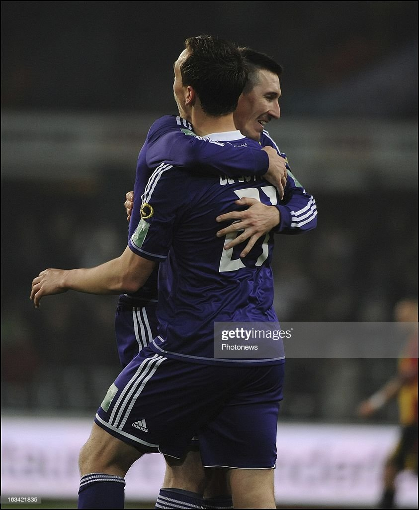 Tom De Sutter of RSC Anderlecht celebrates with teammates after scoring pictured in action during the Jupiler League match between RSC Anderlecht and KV Mechelen on March 9 , 2013 in Anderlecht , Belgium.