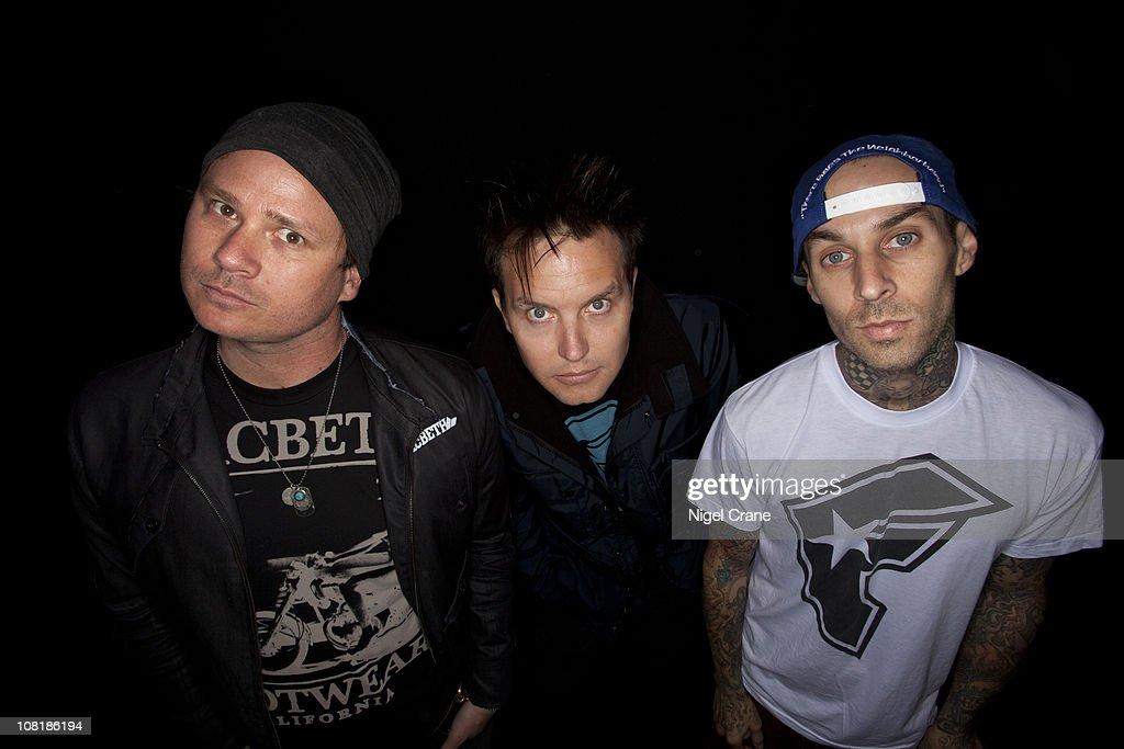 Tom Delonge Mark Hoppus Travis Barker of Blink 182 pose for a photoshoot on August 29 2010 in Reading England