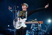 Tom DeLonge of Blink 182 performs on stage at Leeds Festival at Bramham Park on August 22 2014 in Leeds United Kingdom