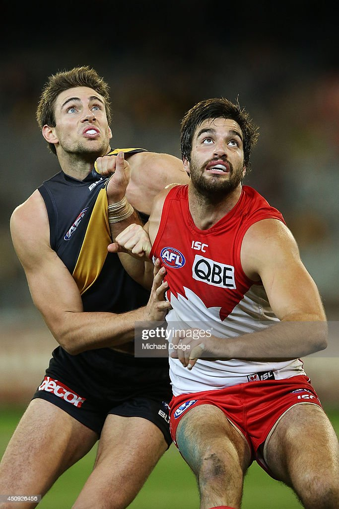 Tom Derickx (R) of the Swans competes for the ball against Shaun Hampson of the Tigers during the round 14 AFL match between the Richmond Tigers and the Sydney Swans at Melbourne Cricket Ground on June 20, 2014 in Melbourne, Australia.