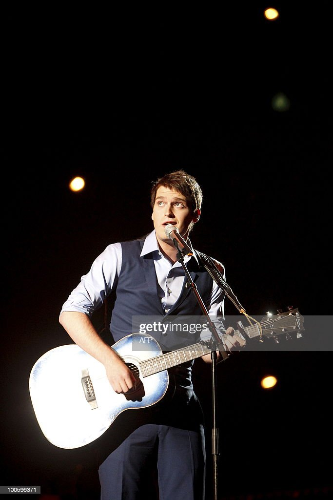 Tom Dice from Belgium performs the song 'Me And My Guitar' during the semi-finals of the Eurovision Song Contest in Telenor Arena in Baerum, Norway, on May 25, 2010. The 55th Eurovision Song Contest finale will take place on May 29 in the Telenor Arena in Oslo, after Norwegian Alexander Rydbak took the top prize in Moscow last year with his song 'Fairytale'. AFP PHOTO/SCANPIX/ Gorm Kallestad ==NORWAY