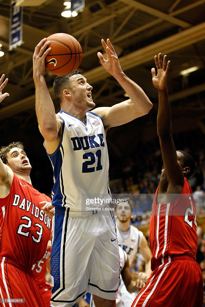 Tom Droney #23 of the Davidson Wildcats tries to stop Miles Plumlee #21 of the Duke Blue Devils on the way to the basket during their game at Cameron Indoor Stadium on November 18, 2011 in Durham, North Carolina.