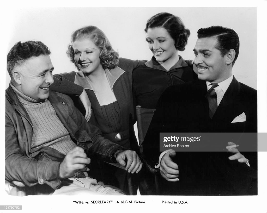 Tom Dugan, Jean Harlow, Myrna Loy, Clark Gable smiling in publicity portrait for the film 'Wife vs. Secretary', 1936.