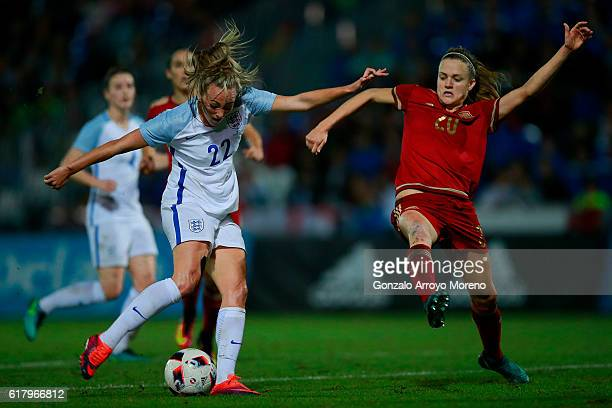 Tom Duggan of England strikes the ball ahead Irene Paredes of Spain during the International Friendly match between Spain and England Women National...