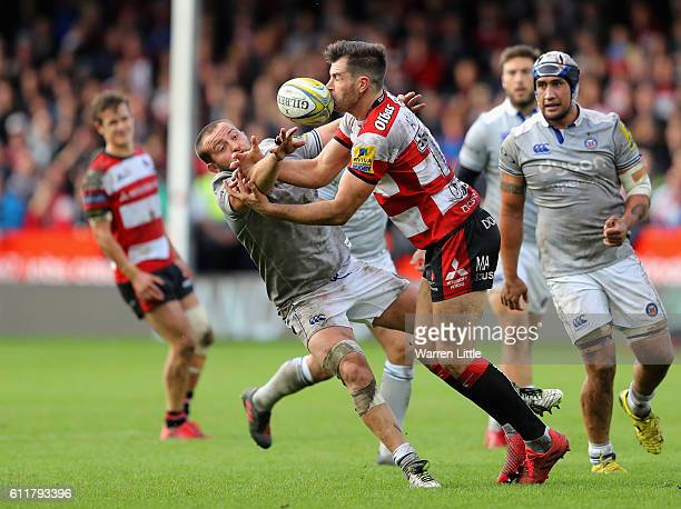 Tom Dunn of Bath Rugby and Mark Atkinson of Gloucester Rugby scramble for the ball during the Aviva Premiership match between Gloucester Rugby and...
