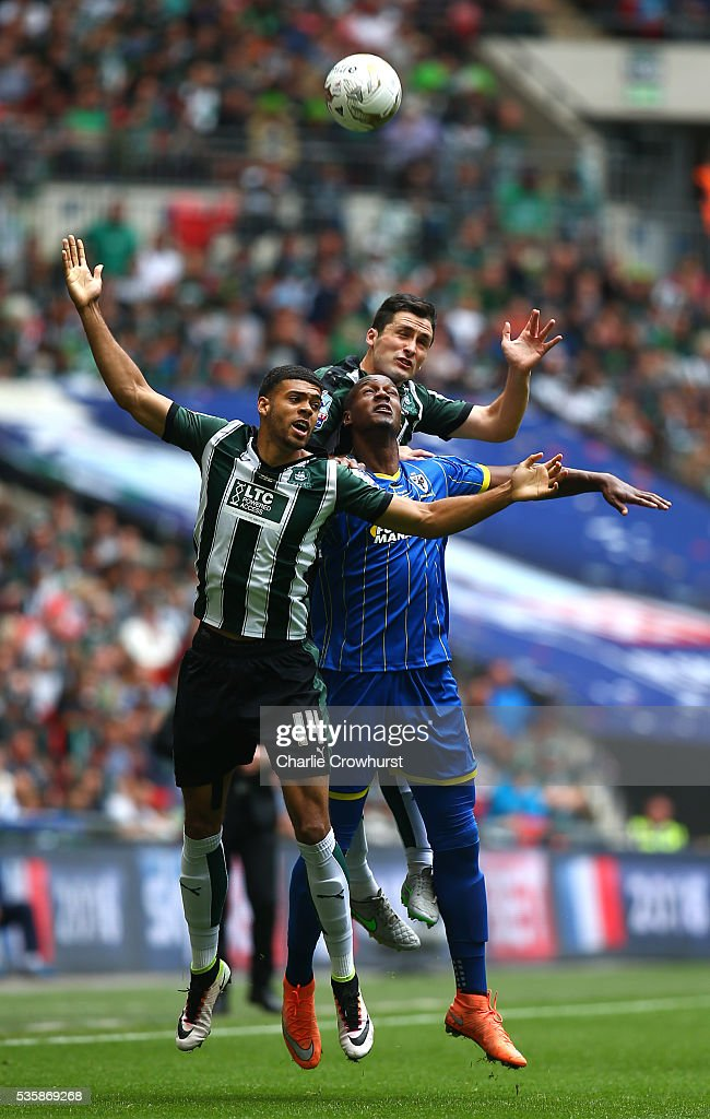 Tom Elliot (C) of AFC Wimbledon is sandwiched between Jake Jervis (L) and Carl McHugh (R) of Plymouth during the Sky Bet League 2 Play Off Final between Plymouth Argyle and AFC Wimbledon at Wembley Stadium on May 30, 2016 in London, England.