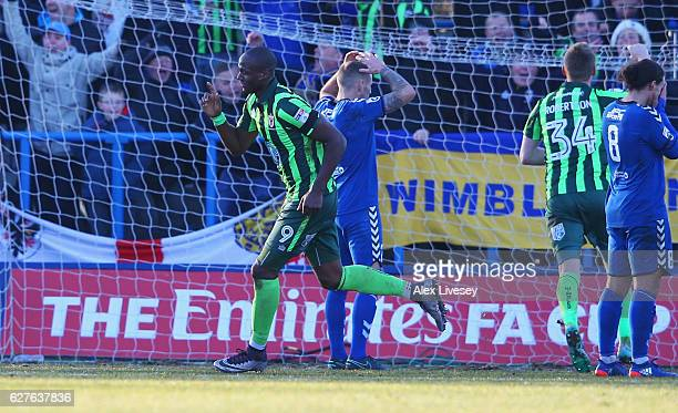 Tom Elliott of AFC Wimbledon celebrates as he scores their fourth goal during the Emirates FA Cup second round match between Curzon Ashton and AFC...