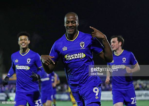 Tom Elliott of AFC Wimbledon celebrates scoring his sides first goal during the Emirates FA Cup third round replay between AFC Wimbledon and Sutton...