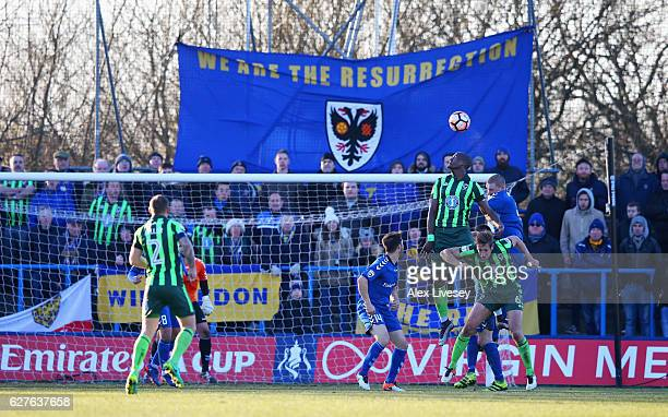 Tom Elliott of AFC Wimbledon rises highest to score their fourth goal during the Emirates FA Cup second round match between Curzon Ashton and AFC...