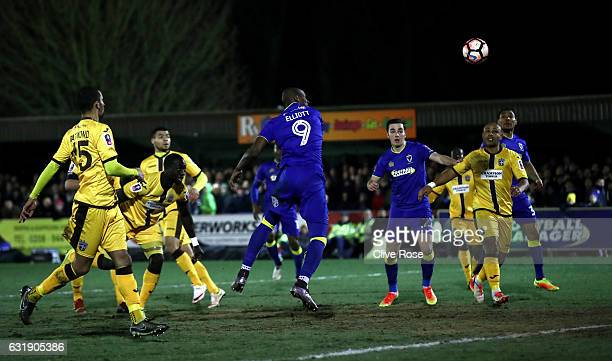 Tom Elliott of AFC Wimbledon scores his sides first goal with a header during the Emirates FA Cup third round replay between AFC Wimbledon and Sutton...