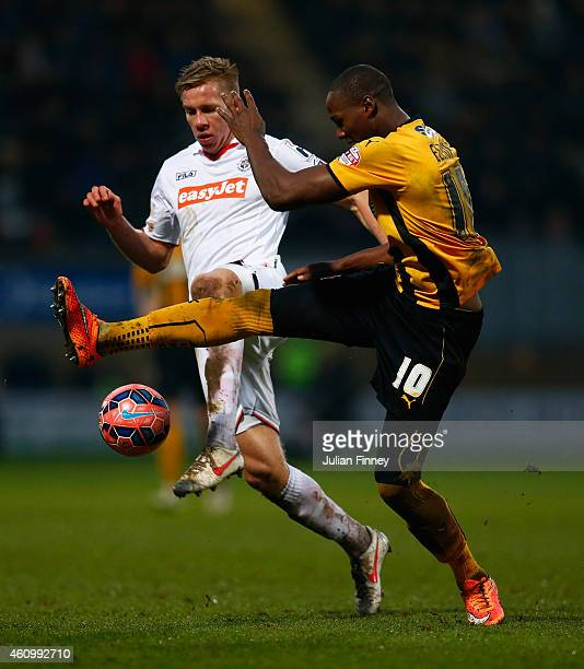 Tom Elliott of Cambridge battles with Jim Stevenson of Luton during the FA Cup Third Round match between Cambridge United and Luton Town at the Abbey...