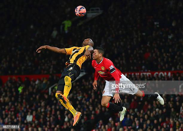 Tom Elliott of Cambridge United and Chris Smalling of Manchester United compete for the header during the FA Cup Fourth round replay match between...