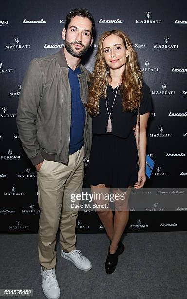 Tom Ellis and Meaghan Oppenheimer attend the UK VIP reveal of the Maserati Levante SUV at The Royal Horticultural Halls on May 26 2016 in London...