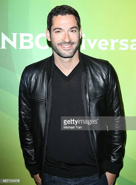 Tom Ellis arrives at NBCUniversal's 2014 Summer TCA Tour Day 1 held at The Beverly Hilton Hotel on July 13 2014 in Beverly Hills California
