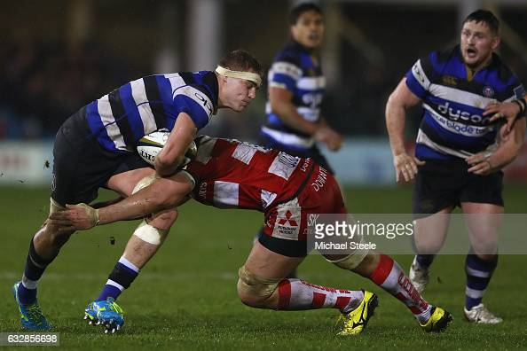 Tom Ellis of Bath is tackled by Joe Batley of Gloucester during the Anglo Welsh Cup match between Bath Rugby and Gloucester Rugby at the Recreation...