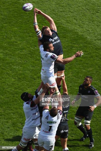 Tom Ellis of Bath jumps with Arnaud Mela of Brive at a lineout during the European Rugby Challenge Cup Quarter Final match between Bath Rugby and...
