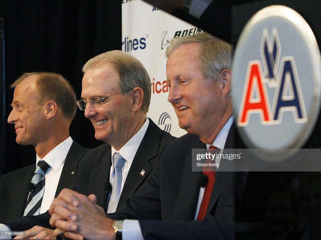 Tom Enders, chief executive officer of Airbus SAS, left, Gerald Arpey, chief executive officer of AMR Corp., the parent company of American Airlines Inc., center, and Jim Albaugh, president of the Boeing Co.'s commerical division, laugh during a news conference in Fort Worth, Texas, U.S., on Wednesday, July 20, 2011. AMR Corp.'s American Airlines agreed to buy 460 single-aisle jets in the industry's biggest-ever order as Airbus SAS broke Boeing Co.'s two-decade hold over the U.S. carrier. Photographer: Mike Fuentes/Bloomberg via Getty Images