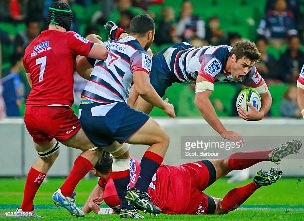 Tom English of the Rebels is tackled during the round eight Super Rugby match between the Rebels and the Reds at AAMI Park on April 3 2015 in...