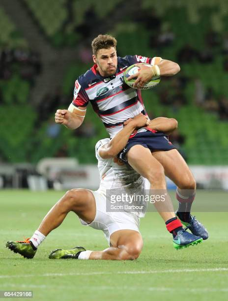 Tom English of the Rebels is tackled during the round four Super Rugby match between the Rebels and the Chiefs at AAMI Park on March 17 2017 in...