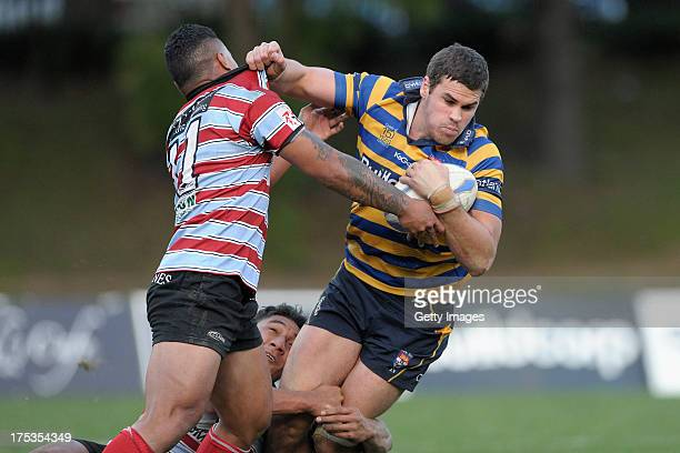 Tom English runs with the ball during the round 16 Shute Shield match between Sydney Uni and Southern Districts at North Sydney Oval on August 3 2013...