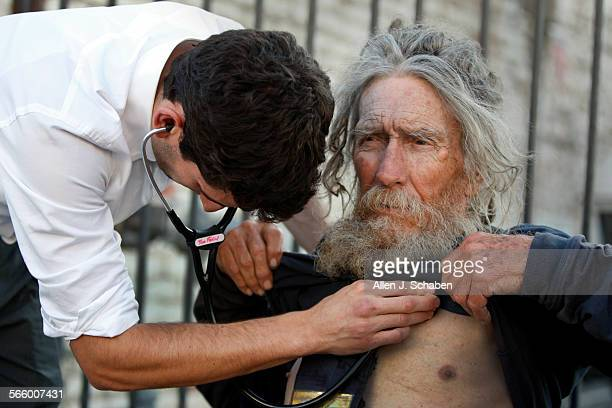 Tom Fadial left a third–year UCLA medical student listens to the heart beat of homeless patient Stanley Rudolph a Korean–era veteran who complained...