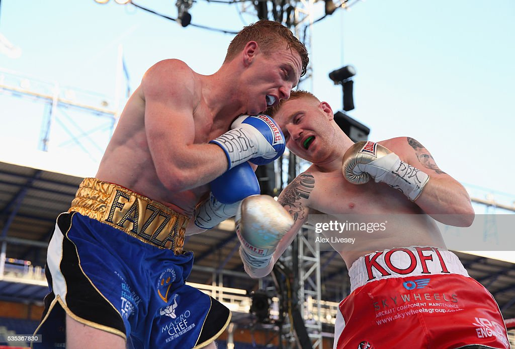 Tom Farrell and Kofi Yates trade punches during the Eliminator for English Super-Lightweight Championship fight between Tom Farrell and Kofi Yates at Goodison Park on May 29, 2016 in Liverpool, England.