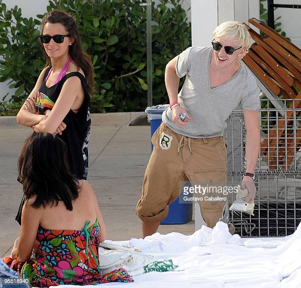 Tom Felton and his girlfriend are seen on Miami Beach on December 31 2009 in Miami Florida on December 31 2009 in Miami Florida