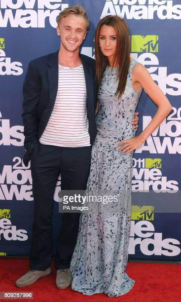 Tom Felton and Jade Olivia at the MTV Movie Awards 2011 at the Gibson Amphitheatre in Universal City Los Angeles
