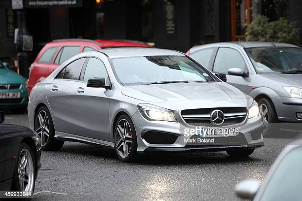 Tom Felton and partner Jade Olivia spotted in Primrose Hill north London with his MercedesBenz CLA 45 AMG on December 4 2014 in London England